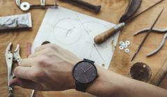Close up of human hand and craft tools, a watch maker. Stock Photos