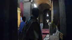 Pilgrims praying in the church of Bete Medhane Alem in Ehtiopia Stock Footage