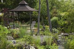 Gazebo in ornamental garden in summer Stock Photos