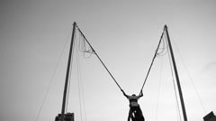 Boy Jumping High at the Bungee Trampoline Stock Footage