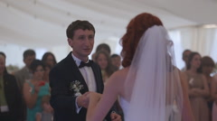 Bride and groom share their first dance together on their wedding day Stock Footage