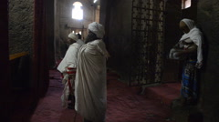 Pilgrims praying in the church of Bete Medhane Alem in Ethiopia Stock Footage
