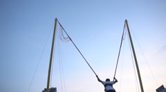 Child on Bungee Ride Stock Footage