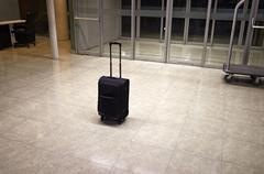 Abandoned luggage in building Stock Photos