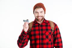 Smiling casual man holding gas lighter - stock photo