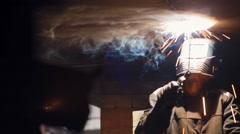 Focus is transferred from one to another welder Stock Footage