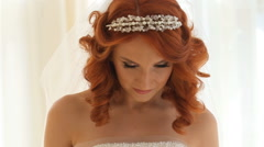 Elegant brunette bride wear beautiful earrings HD - stock footage
