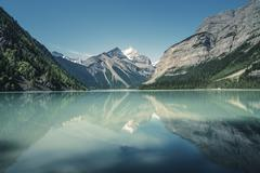 View of lake, forests and snow capped mountain, British Columbia, Canada - stock photo