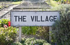 Village sign in garden - stock photo