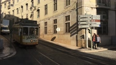 Pan following a Yellow tram passing by Stock Footage
