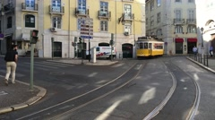 Trams passing by in the old town of Lisbon Portugal Stock Footage