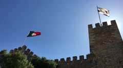 Lisbon and portugal flag at the Castelo de S. Jorge in Lisbon Stock Footage