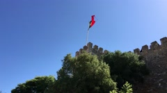 Portugal flag at the Castelo de S. Jorge in Lisbon Stock Footage