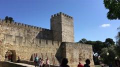 Tourists walking at the Castelo de S. Jorge in Lisbon Stock Footage