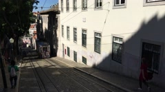 A tram driving up the hill in Lisbon Stock Footage