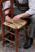 mender of chairs while repairing old wooden chair - stock photo