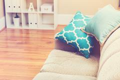 Bright living room interior with turquoise pillows Stock Photos