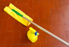 A tool for dusting the floors and the cleaner to wash it Stock Photos
