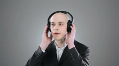 Young elegant bald man is listening music and singing isolated on white Stock Footage