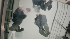 View from below people talking on stairs - stock footage
