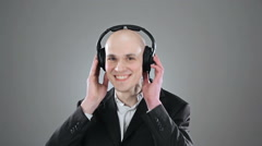 Young elegant bald man is listening music isolated on white Stock Footage