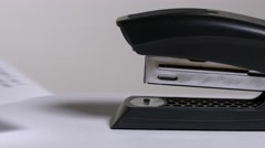 Close up of stapler, stapling sheets of paper 2 Stock Footage