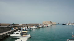 Nice view of Heraklion pier, docked boats in the Greek harbor. Stock Footage