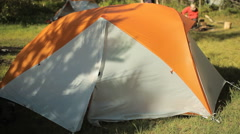 Man makes touch tablet out of the tent. Open the tent, touch tablet's screen and Stock Footage