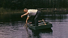 USA 1941: old man fishing in a small boat Stock Footage