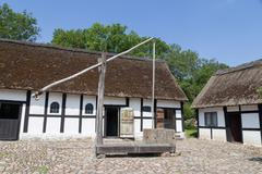 Sweep well in courtyard of old danish farmhouse - stock photo