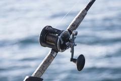Fishing reel, close up Stock Photos