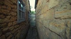 Through a narrow alley Stock Footage