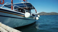 Small ship in the harbor, view of Crete, sea. - stock footage