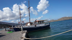 Small ship in the harbor, view of Crete, sea. Camera is on the ship deck. Stock Footage