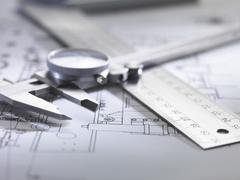 Engineering measurement and drawing equipment on design drawing - stock photo