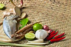 Local ingredient soup tom yam on natural wicker mat background Stock Photos