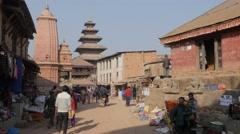 People walking through small street to Taumadhi  square,Bhaktapur,Nepal Stock Footage