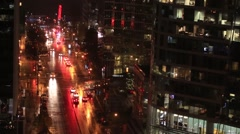 Wet city street at night Stock Footage