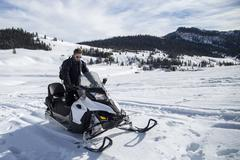 Man on snowmobile, Jackson Hole, Wyoming - stock photo