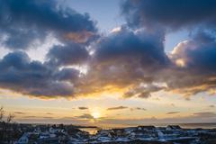 Sunlight through clouds, Reine, Lofoten, Norway Stock Photos