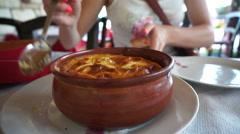 Greek outdoor restaurant, moussaka. Stock Footage