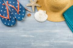Some beach accessories on a wooden background - stock photo