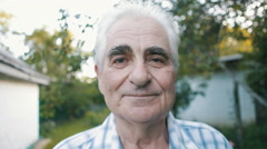 Portrait of an old man with gray hair outdoor Stock Footage