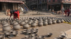 Woman turning drying pottery on square,Bhaktapur,Nepal Stock Footage