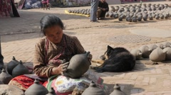 Woman making pottery on square,Bhaktapur,Nepal Stock Footage