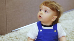 Child in room enjoys soap bubbles mom Stock Footage