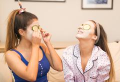 Two young women wearing face masks Stock Photos