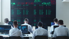 Group of Stockbrockers Actively Working at Stock Exchange - stock footage