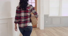 Woman Handing Package To Courier At Home Shot On R3D Stock Footage