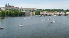 People are enjoying a cruise on a pedal boat in Vltava river in Prague. Stock Footage